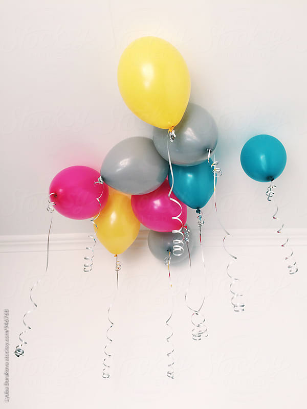 Bright balloons under the ceiling by Lyuba Burakova for Stocksy United