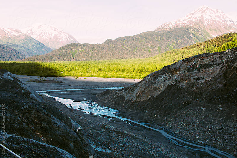 A Glacial Stream Slithers Through The Mountain Foothills In Alaska by Luke Mattson for Stocksy United