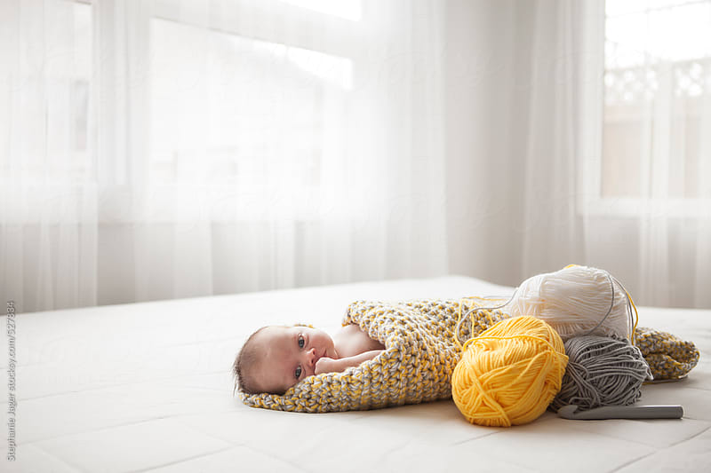 Baby in crochet blanket by Stephanie Jager for Stocksy United