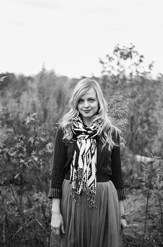Black and white portrait of a beautiful blonde woman standing in a field by Jakob for Stocksy United