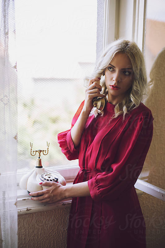 Attractive young woman on the phone by Jovana Rikalo for Stocksy United