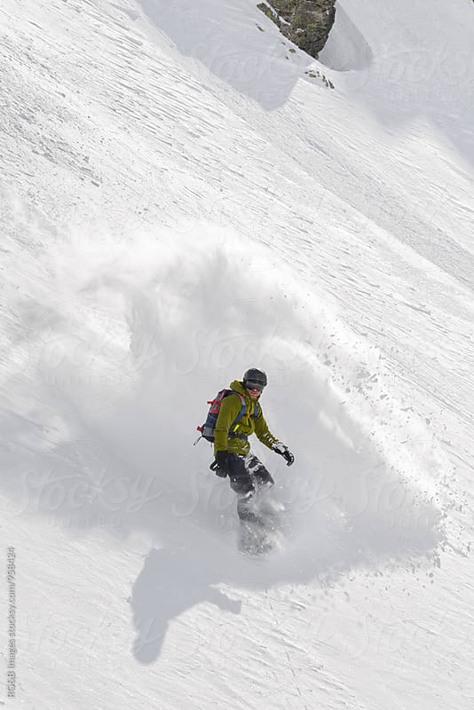 Snowboarder riding downhill with speed by RG&B Images for Stocksy United