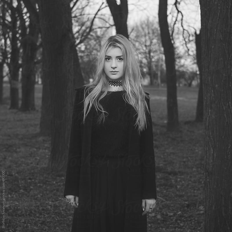 Portrait of a beautiful young woman in the woods by Brkati Krokodil for Stocksy United