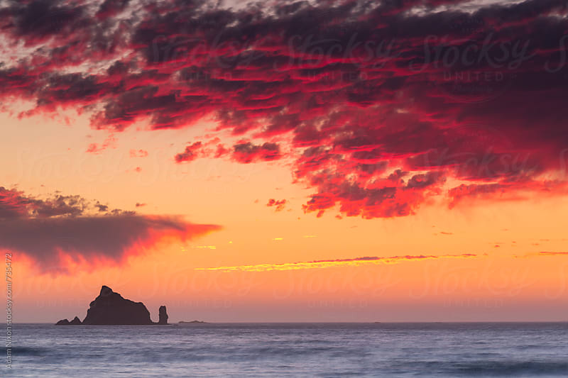 Blood red skies over the Pacific Ocean from Rialto Beach, Washington by Adam Nixon for Stocksy United