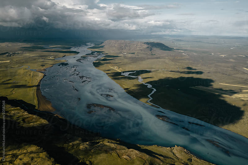 Flight over Icelandic lakes, mountains and rivers by Christian McLeod for Stocksy United