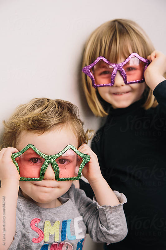 Children wearing star glasses by Ali Lanenga for Stocksy United