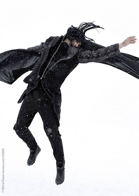Jumping person with black cape by T-REX & Flower for Stocksy United