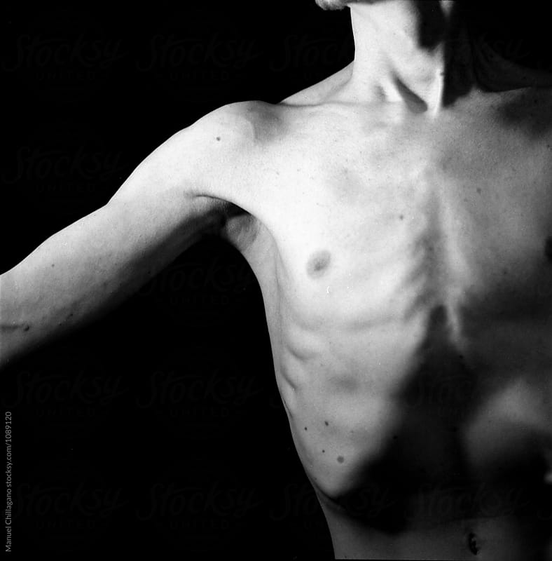 Detail of a young male torso in Black and white by Manuel Chillagano for Stocksy United