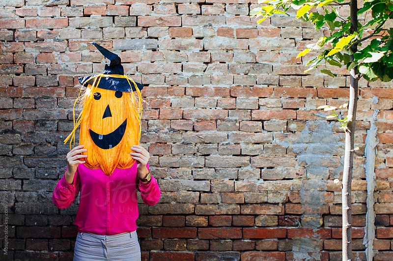 Anonymous Woman Behind the Halloween Mask by Mosuno for Stocksy United