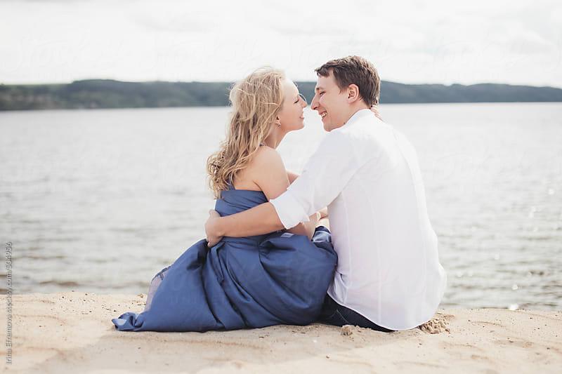 Couple on the beach by Irina Efremova for Stocksy United