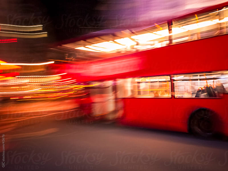 Fast bus running in the city by GIC for Stocksy United