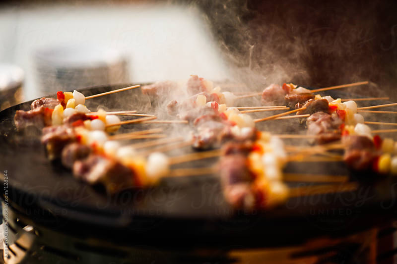 Beef shish kabobs on the grill by Leandro Crespi for Stocksy United