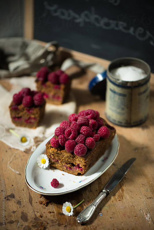 raspberries plum cake by Laura Adani for Stocksy United