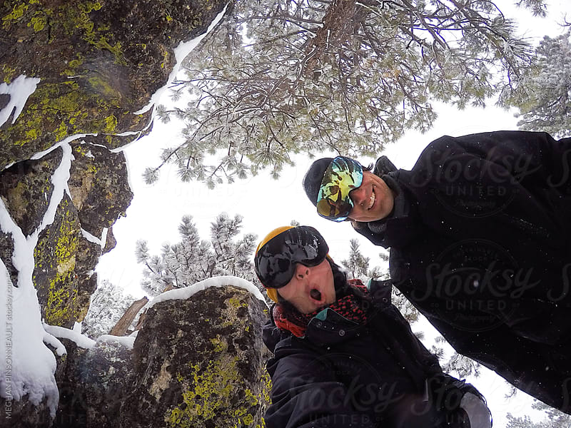 Adventurous Couple Having Fun in Wintery Forest by MEGHAN PINSONNEAULT for Stocksy United