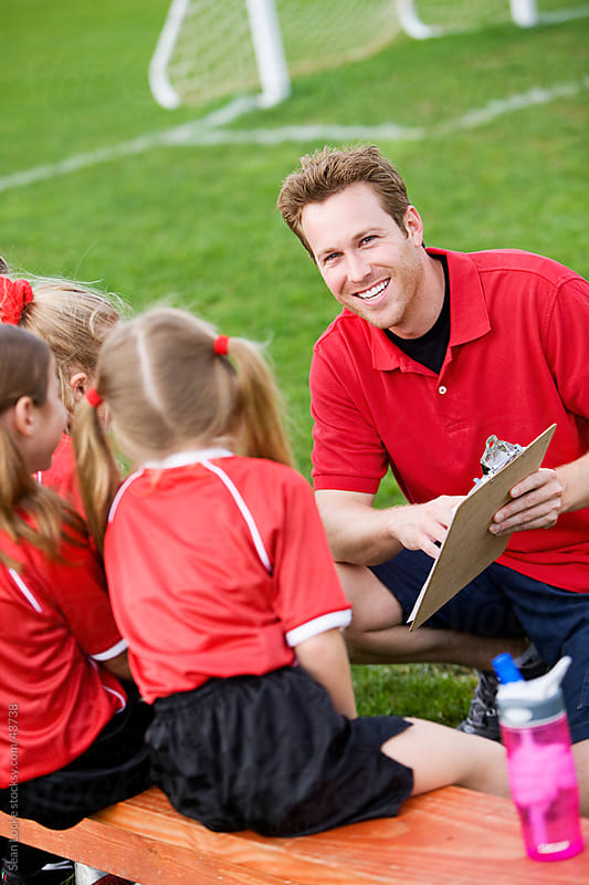 Soccer: Coach Teaching Team Strategy by Sean Locke for Stocksy United