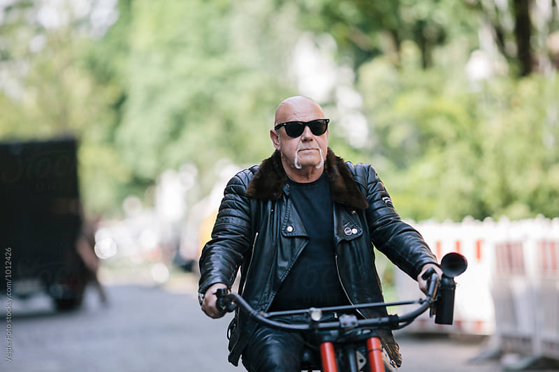 Senior adult riding E-Bike by VegterFoto for Stocksy United