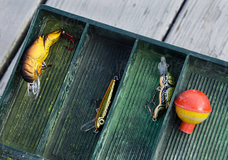 Tackle box with fishing lures and bobber by Cara Dolan for Stocksy United