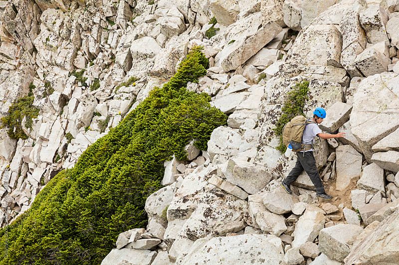 Young Climber Traverses Mountain Boulder Field by Odyssey Stock for Stocksy United