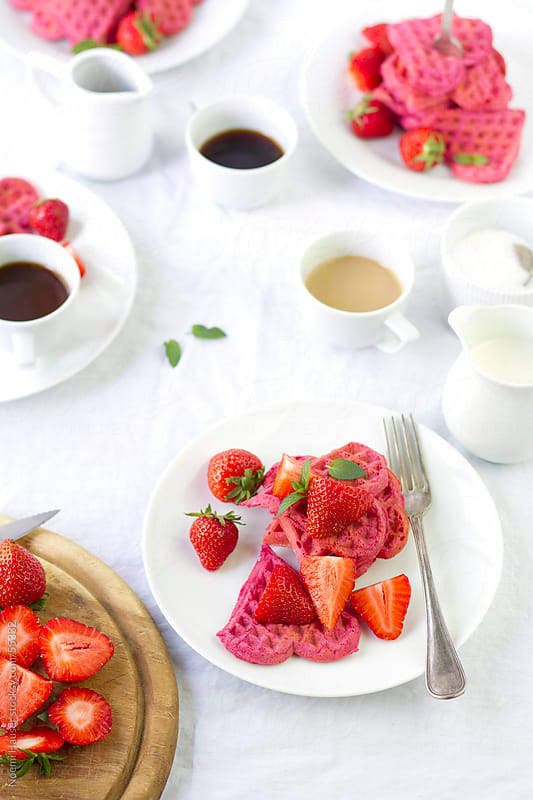 Beetroot waffles with strawberries by Noemi Hauser for Stocksy United