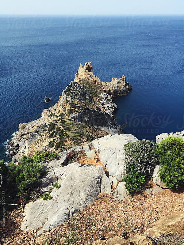 View from a cliff over the sea, Sardinia by Luca Pierro for Stocksy United