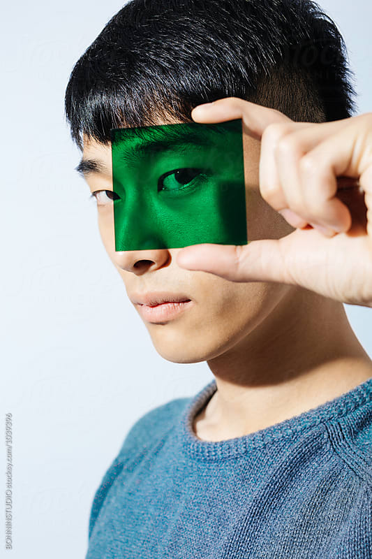 Portrait of an asian man holding a green glass. by BONNINSTUDIO for Stocksy United
