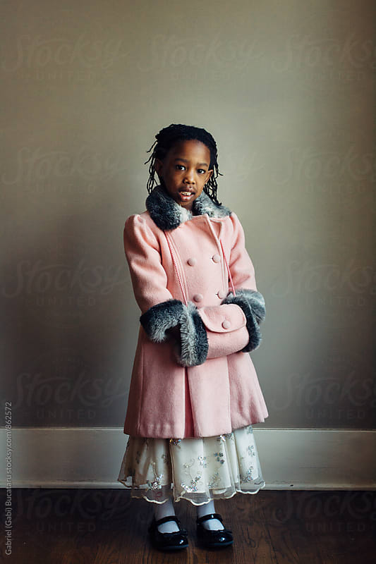 Cute black girl wearing a vintage pink coat by Gabriel (Gabi) Bucataru for Stocksy United