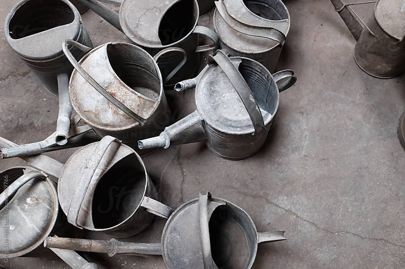 Old antique galvanized metal aluminum watering can buckets by Greg Schmigel for Stocksy United