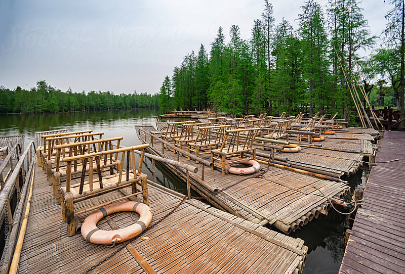 Raft at the pier, Next to water forest,China by Miss Rein for Stocksy United