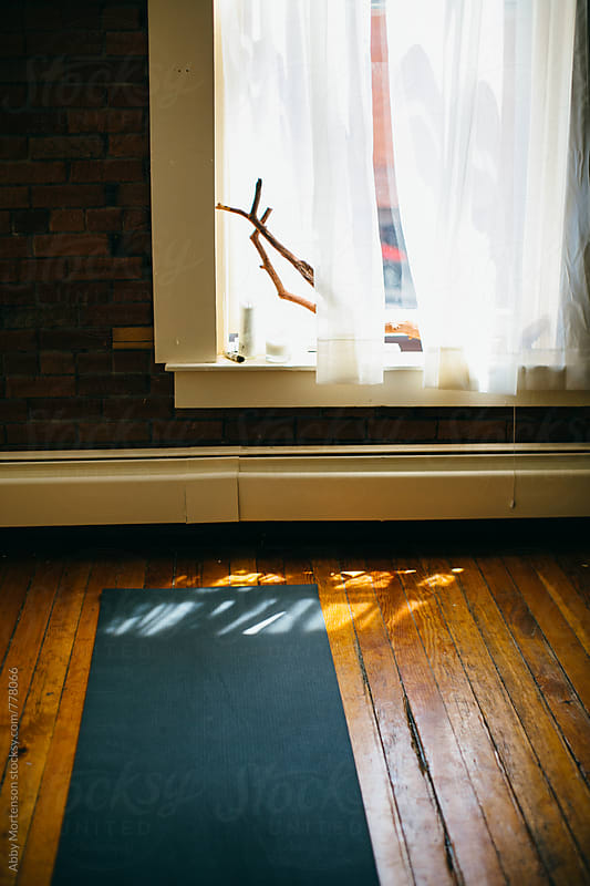 Yoga Mat in Studio with Shadows  by Abby Mortenson for Stocksy United