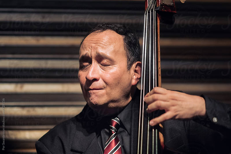 Passionate double bass musician giving a concert by Per Swantesson for Stocksy United