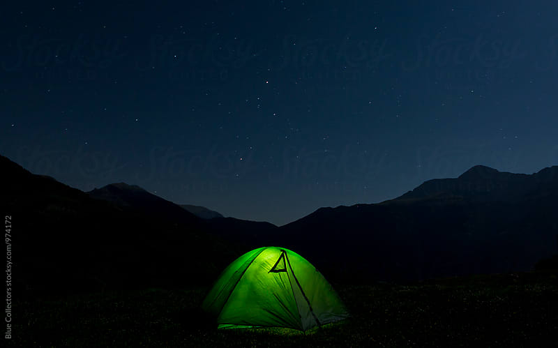 Night camp under the starry sky by Jordi Rulló for Stocksy United