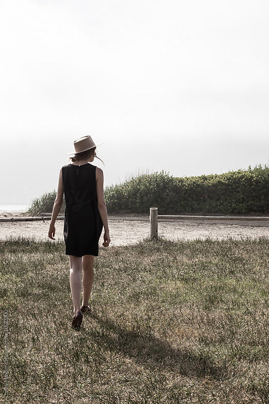 Woman Walking To A Beach by Carey Haider for Stocksy United