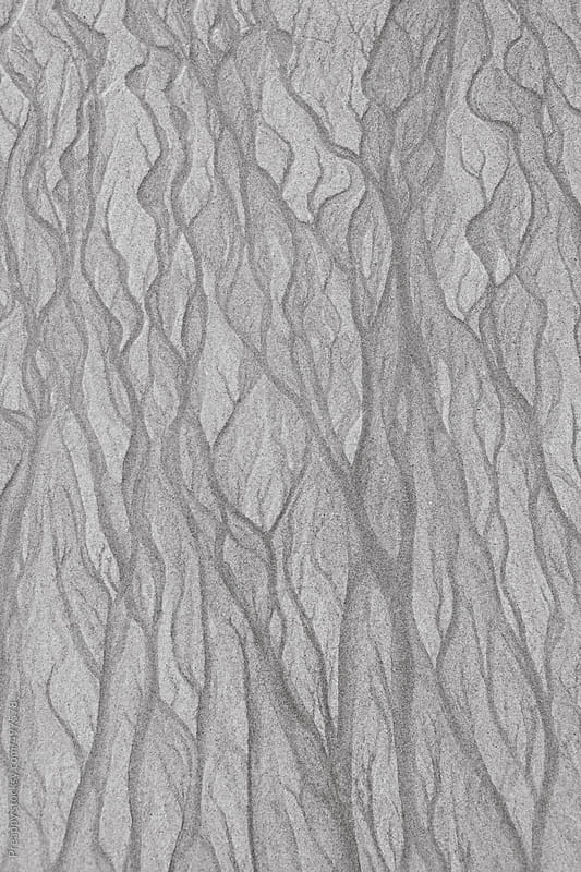 Patterns in wet sand formed by receding tide by Preappy for Stocksy United