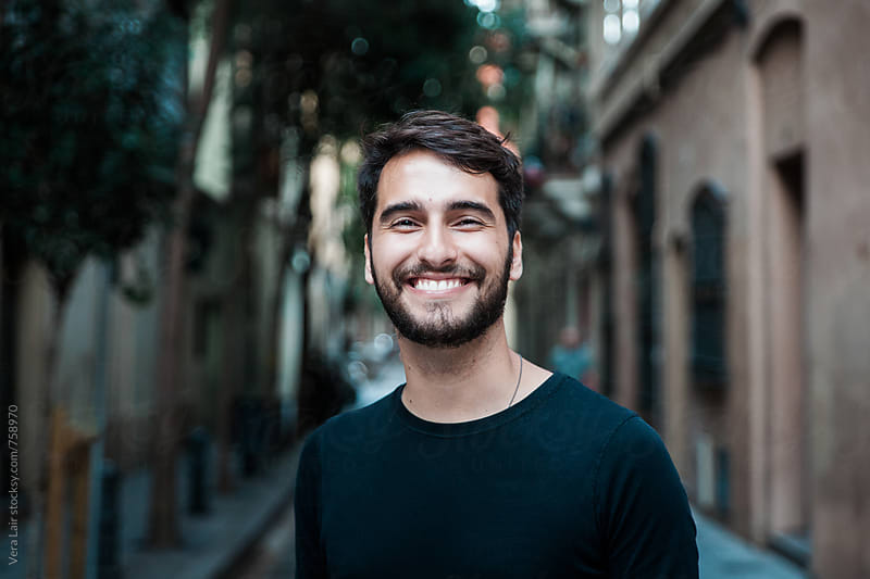 Portrait of a happy young man by Vera Lair for Stocksy United