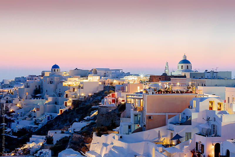 Pastel colours of Oia, Santorini just after sunset by Paul Phillips for Stocksy United