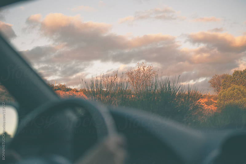 Close up of a woman driving a car. by BONNINSTUDIO for Stocksy United