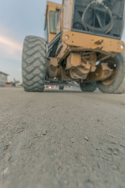 Heavy Construction Equipment Rebuilding a Road by suzanne clements for Stocksy United