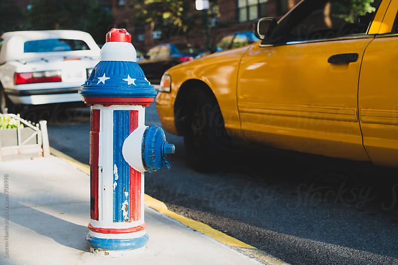 American flag fire hydrant by Lauren Naefe for Stocksy United