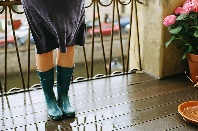 Woman wearing  rubber boots on a balcony by Lyuba Burakova for Stocksy United