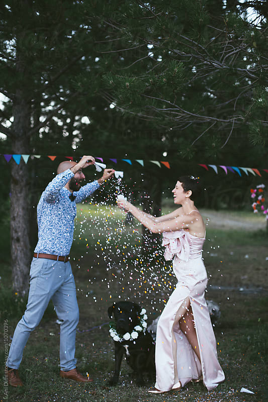 Confetti fight by Ani Dimi for Stocksy United