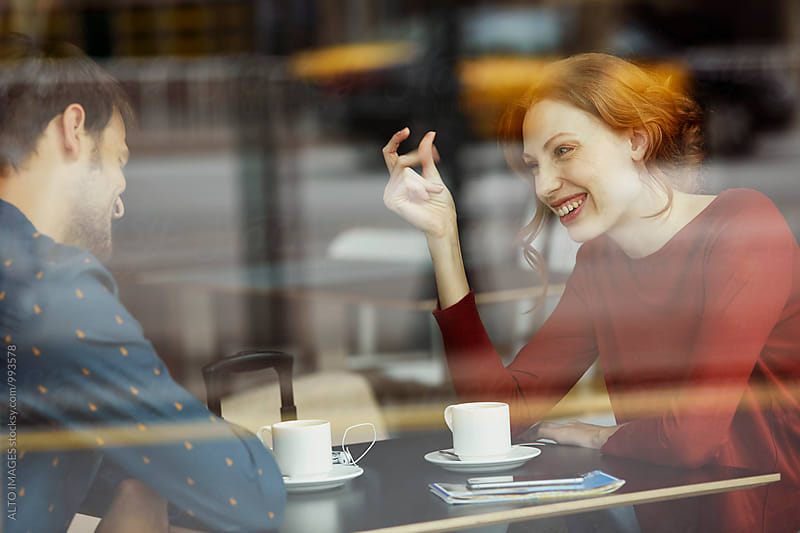 Smiling Woman Talking With Boyfriend In Restaurant by ALTO IMAGES for Stocksy United