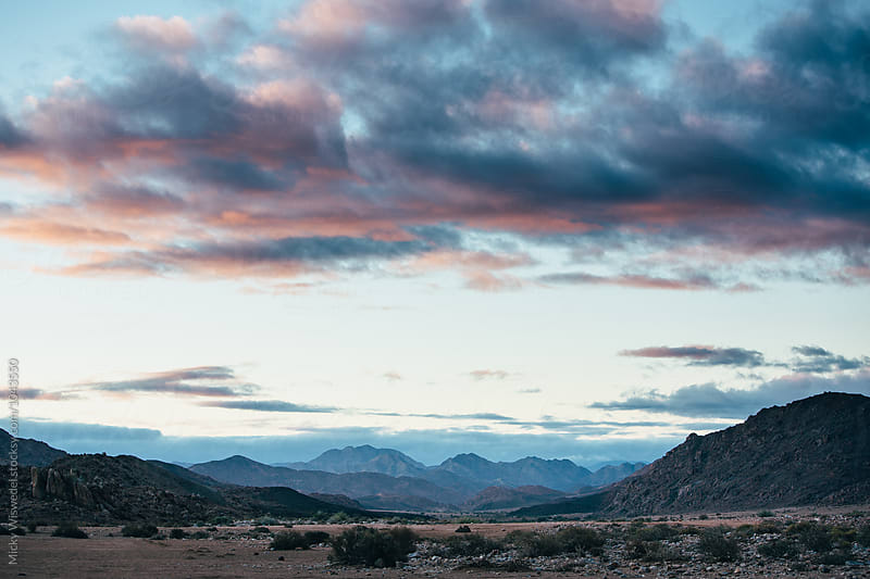 mountainous desert landscape at sunset by Micky Wiswedel for Stocksy United