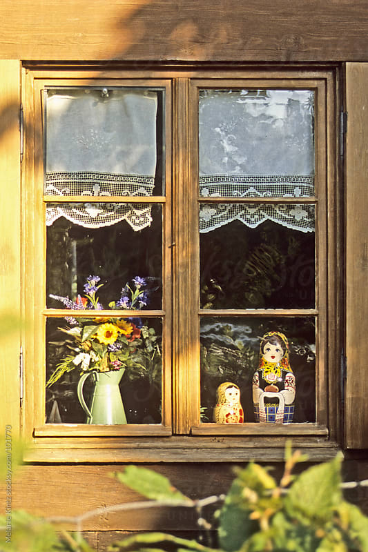 Russian style decorated window on a sunny day by Melanie Kintz for Stocksy United