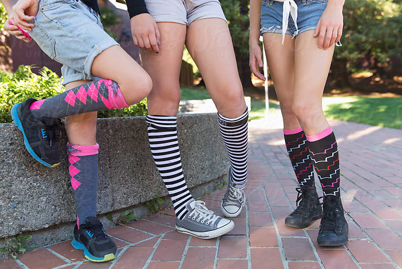 three tweens hanging out by Tanya Constantine for Stocksy United