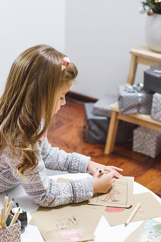 Toddler Drawing on the Christmas Cards by Aleksandra Jankovic for Stocksy United
