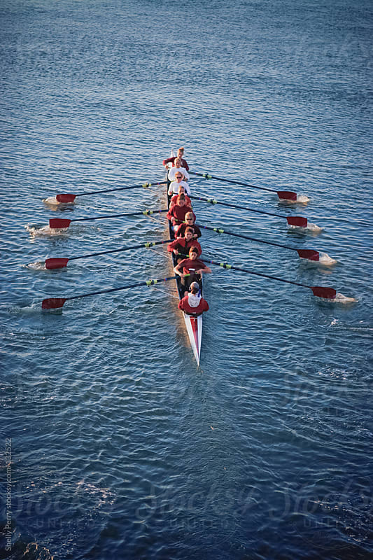 Women's crew team rowing in unison by Shelly Perry for Stocksy United