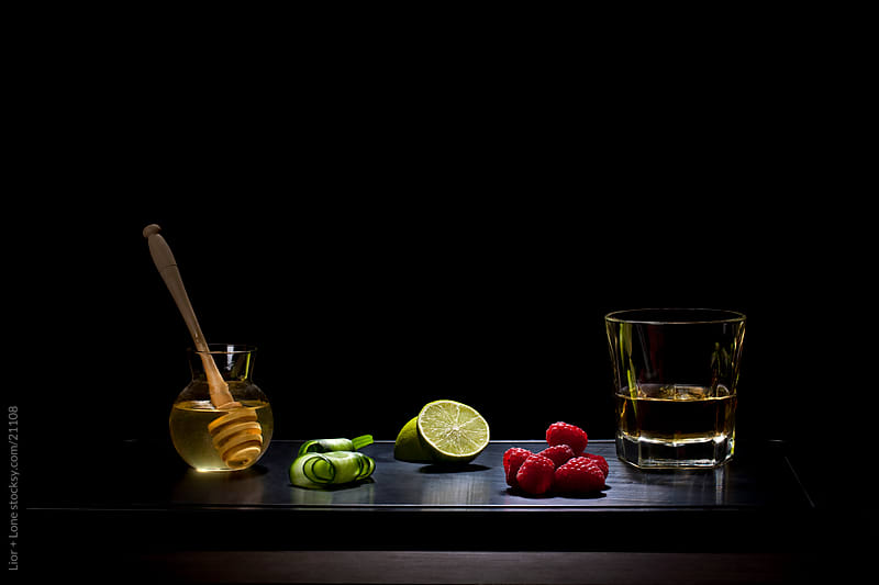 Raw ingredients and whiskey by Lior + Lone for Stocksy United