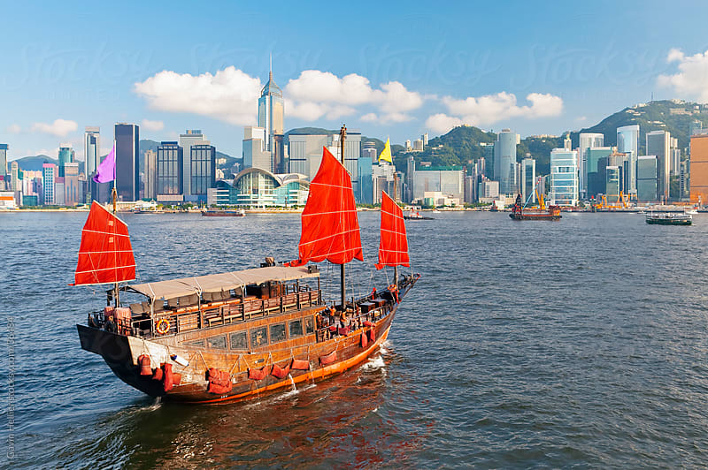 One of the last remaining Chinese sailing junks on Victoria Harbour, Hong Kong, China, Asia, viewed from Kowloon by Gavin Hellier for Stocksy United