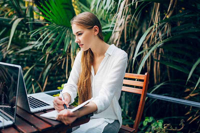 Businesswoman Working in a Tropical Garden by Lumina for Stocksy United