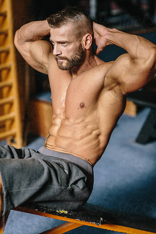 Bodybuilder working out by Peter Meciar for Stocksy United